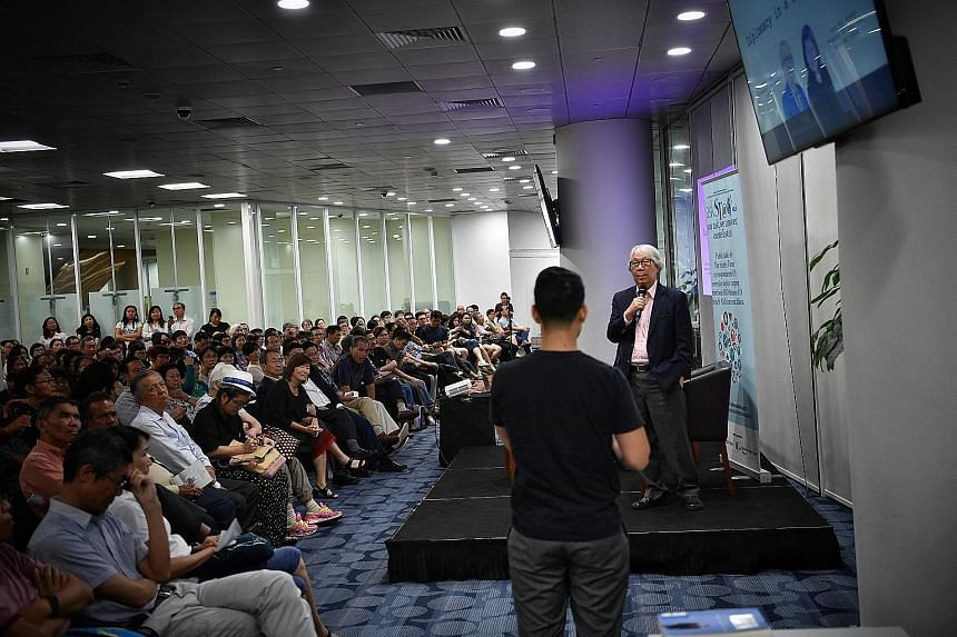 Entrepreneur Chua Cheng Xun (in foreground, with back facing) asking Professor Tommy Koh a question yesterday. Some 350 people attended the askST@NLB session at the National Library, which was the first to feature a guest speaker. The next askST@NLB