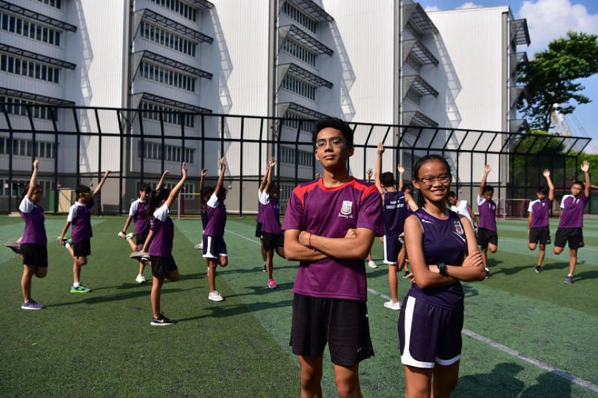Michael Chang and Tan Jia Qi are among 25 Queensway Secondary School athletics team members who will take part in the ST Run on Sept 23, 2018.