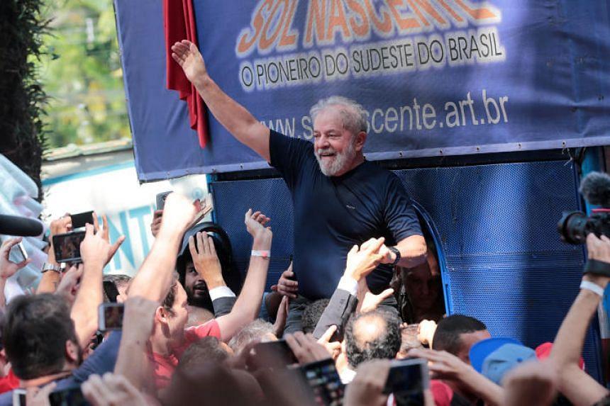 Former Brazilian President Luiz Inacio Lula da Silva is carried by supporters in front of the metallurgic trade union in Sao Bernardo do Campo, Brazil, on April 7, 2018.