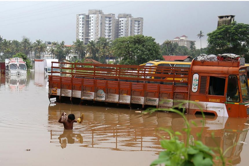 A man wades through flooded water in Kochi, Kerala, on Aug 16, 2018.