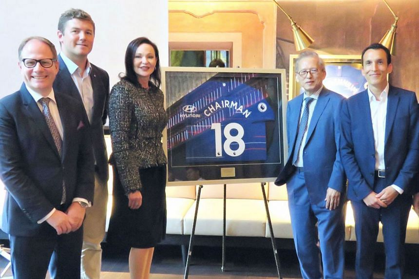 Kwek Leng Beng (second from right), has inked an exclusive partnership with Chelsea Football Club. With him are (from left) Millennium Hotels and Resorts group chief marketing officer Simon Scoot, Chelsea's head of partnership management (Asia) Chris Mads