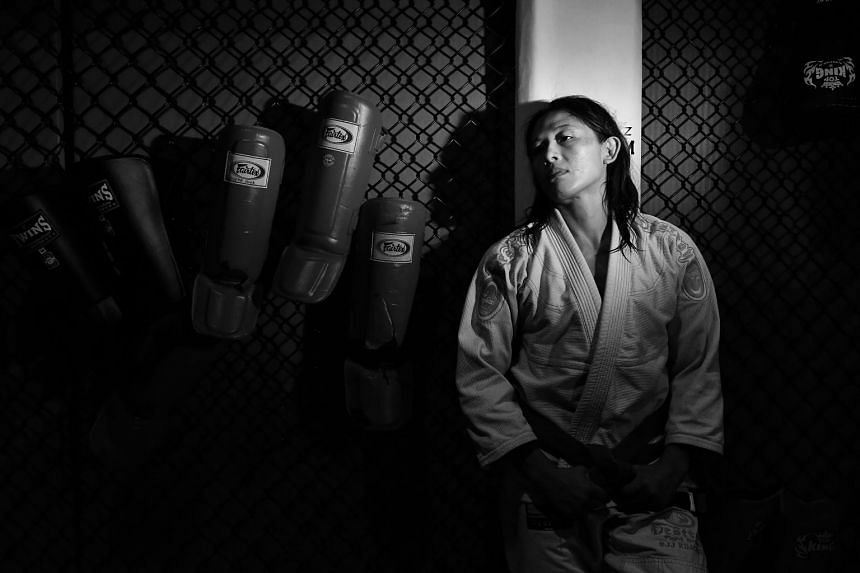 Ooi, 41, is training for the Asian Games, where she will fly the Republic's flag in ju-jitsu.