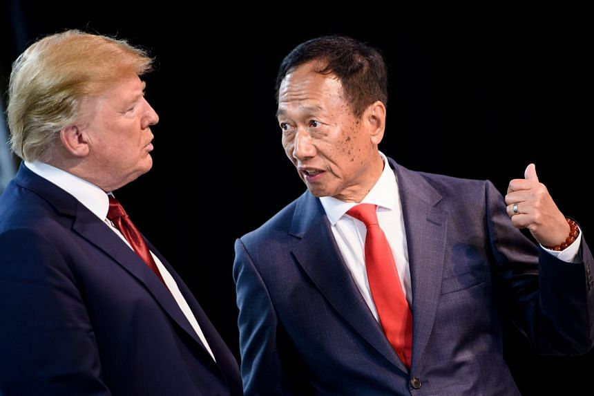 US President Donald Trump (left) and Foxconn Chairman Terry Gou tour a Foxconn facility at the Wisconsin Valley Science and Technology Park on June 28, 2018.
