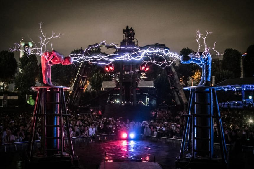 A lightning duel by Britain-based group Lords of Lightning, where performers battle using shards of lighting atop two Tesla coils at Cathay Green in Dhoby Ghaut.