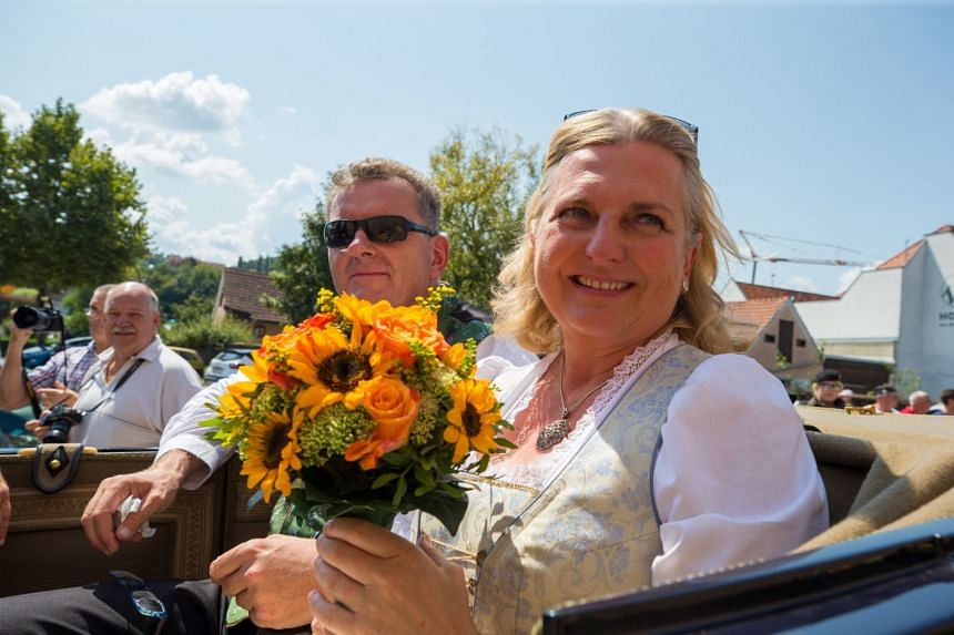 Austrian Foreign Minister Karin Kneissl (right) and her husband Wolfgang Meilinger on their wedding day .