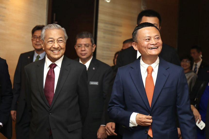 Dr Mahathir (left) accompanied by Alibaba Group's chairman Jack Ma, visits Alibaba's headquarters in Hangzhou in east China's Zhejiang province, Aug 18, 2018.