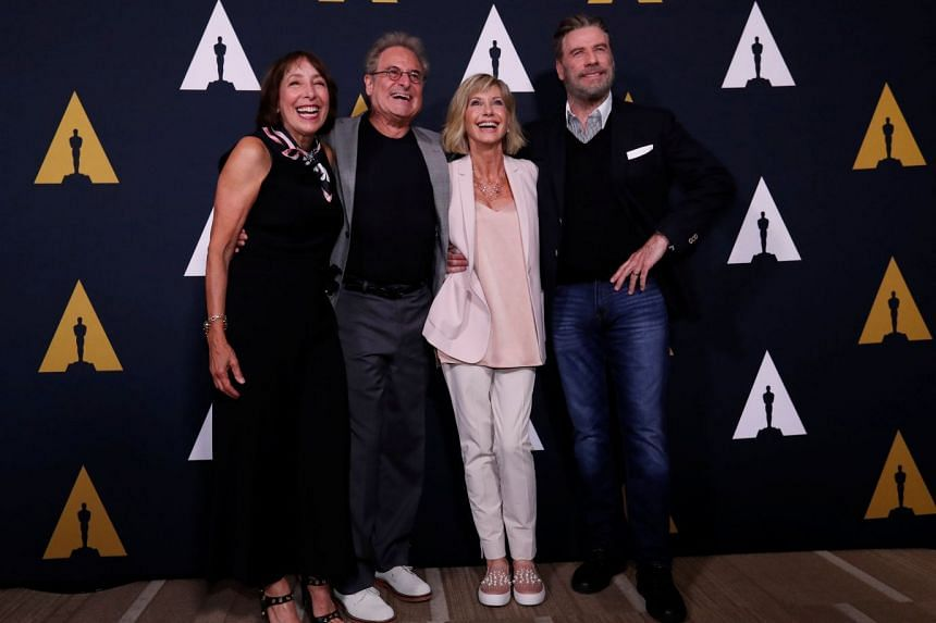 "From left: Cast members Didi Conn, Barry Pearl, Olivia Newton-John and John Travolta pose at a 40th anniversary screening of ""Grease"" at the Academy of Motion Picture Arts and Sciences."