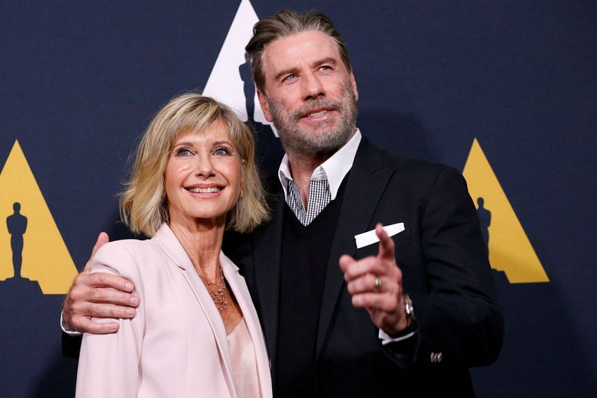 "Cast members John Travolta (right) and Olivia Newton-John posing at the 40th anniversary screening of ""Grease"" at the Academy of Motion Picture Arts and Sciences."
