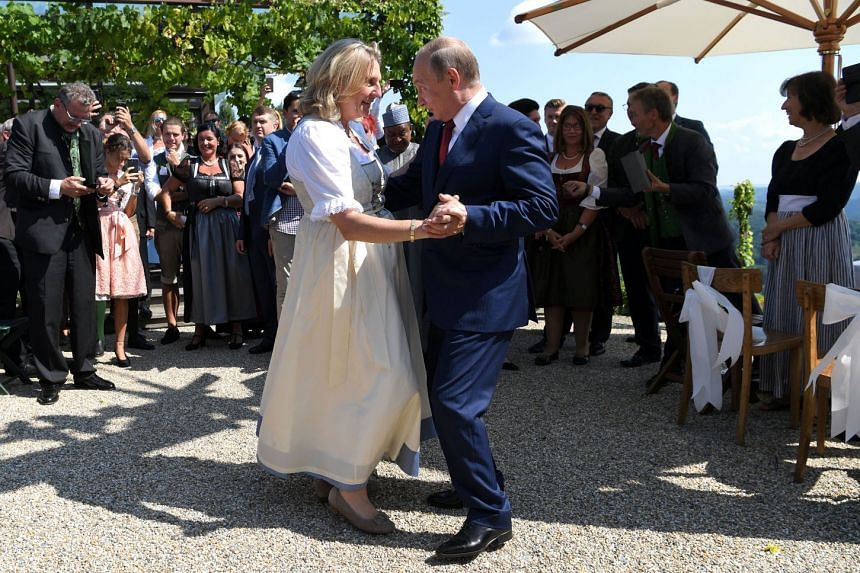 Austria's Foreign Minister Karin Kneissl dances with Russia's President Vladimir Putin at her wedding.