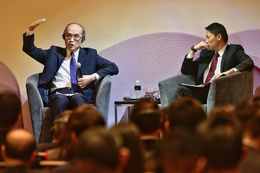 China's Prosecutor-General Zhang Jun at the dialogue yesterday with the moderator, Solicitor-General and Senior Counsel Kwek Mean Luck. Mr Zhang says the difference between China's brand of rule of law and Western models is its one-party governance.