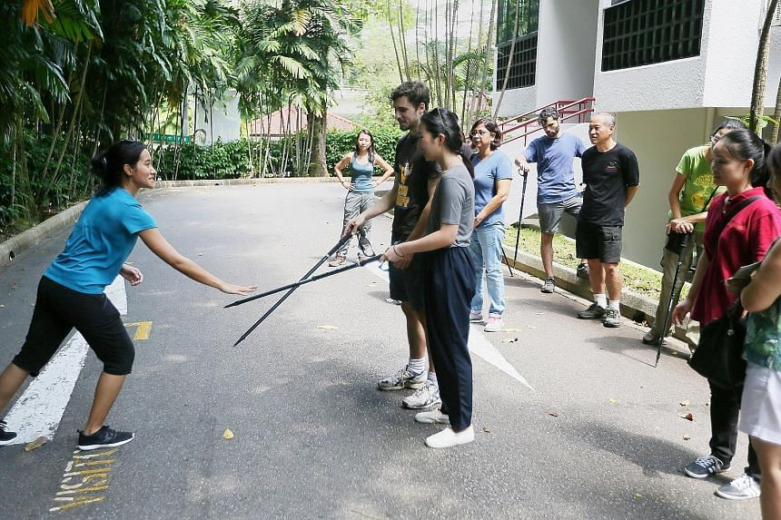 Ms Sabrina Jabbar, a primate researcher at the Jane Goodall Institute Singapore, training volunteers to become monkey guards at Dairy Farm Estate.