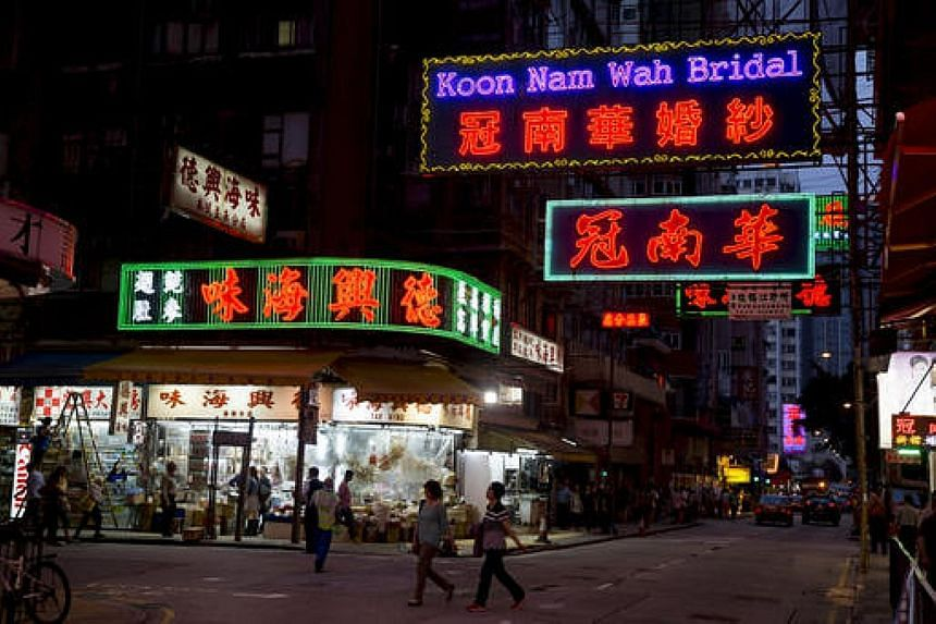 Neon street signs of Hong Kong businesses such as Koon Nam Wah bridal store may be gone soon as they face pressure to switch to LED lights.