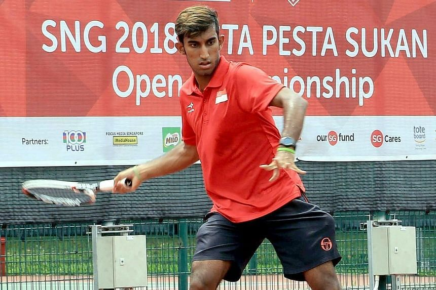 Shaheed Alam in action during the recent Singapore National Games-Singapore Tennis Association Pesta Sukan Open Championship, where he won the men's singles, men's doubles (partnering Rohan Kandar) and mixed doubles (partnering Evelina Kontarev) titl