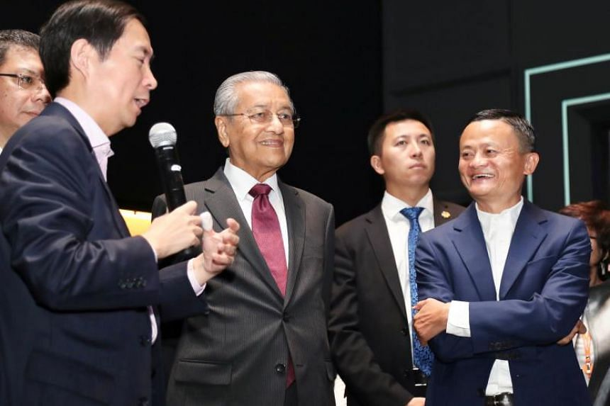 Malaysian prime Minister Mahathir Mohamad (second from left) tours the Alibaba Corporate headquarters with Alibaba Group founder Jack Ma (right) in Hangzhou on Aug 18, 2018.