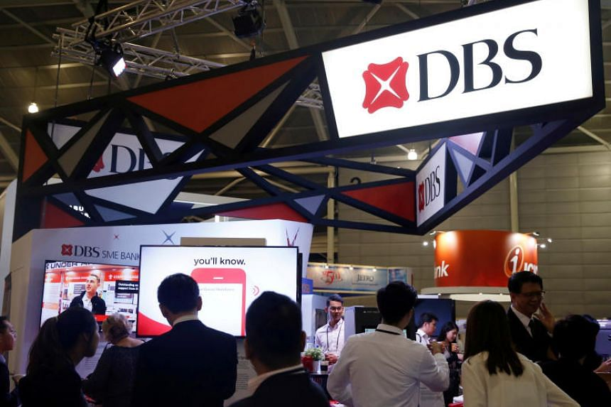 """Since March, DBS Bank has been offering a """"cash back"""" incentive of up to $50 a month for customers who withdraw $400 or less from its ATMs or branches."""