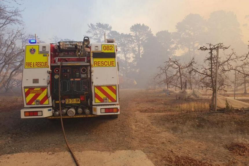 A fire engine is parked near a bushfire in New South Wales, Australia on Aug 15, 2018.