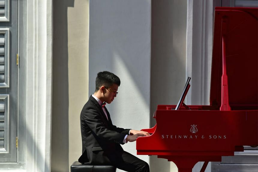Isaiah Hui performs on a Red Steinway Concert Grand piano at the National Museum of Singapore on Aug 18, 2018.
