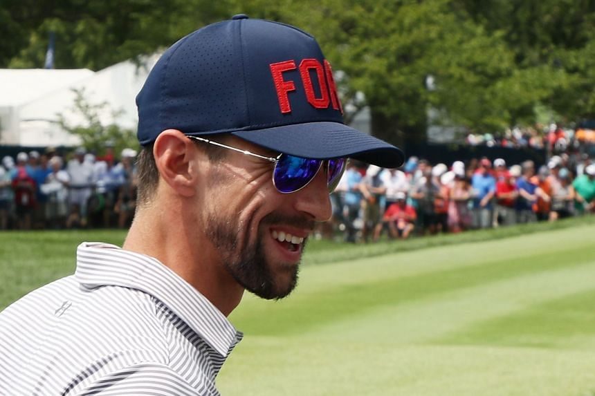 Phelps looking on during the final round of golf in the 2018 PGA Championship on Aug 12, 2018.