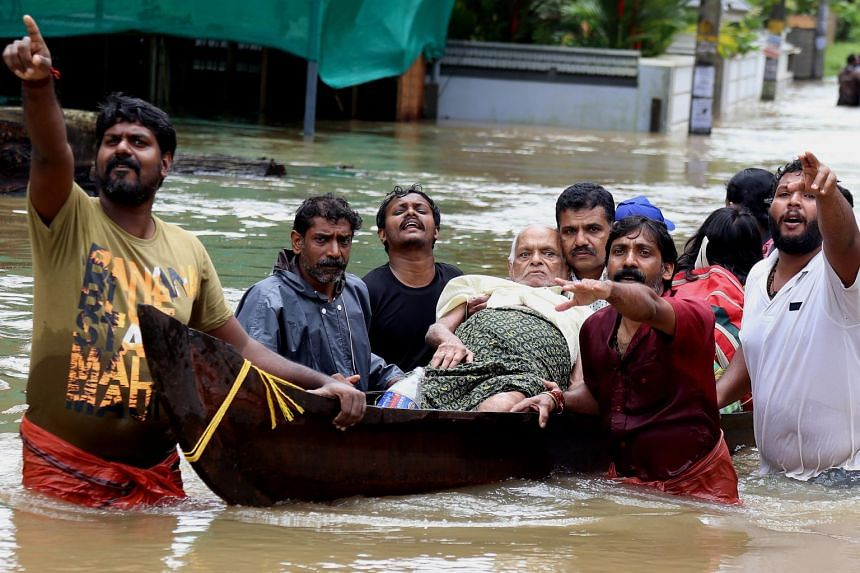 An elderly man is rescued in a boat in Kochi, Kerala state, India, on Aug 17, 2018.