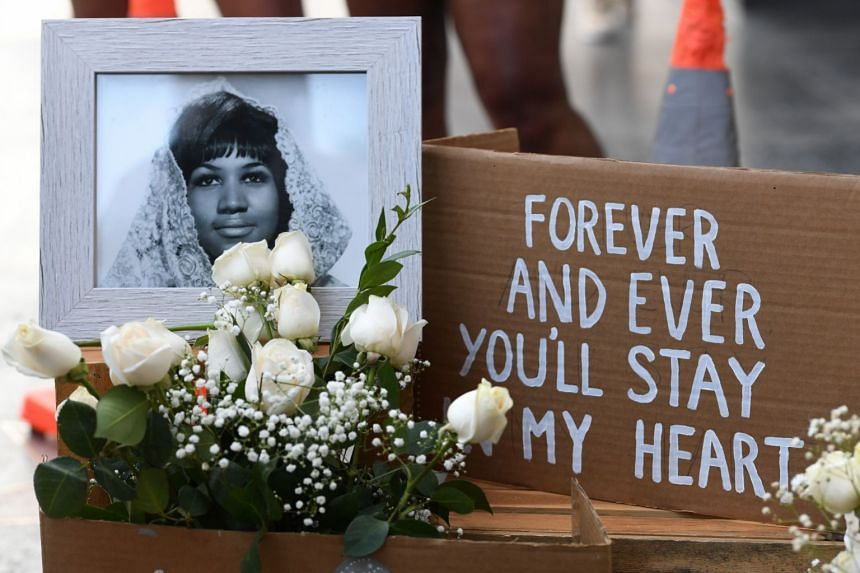 Flowers and tributes are placed on the Star for Aretha Franklin on the Hollywood Walk of Fame.