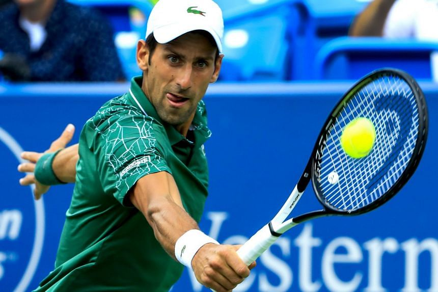 Djokovic in action against Marin Cilic of Croatia during their semi-final match.