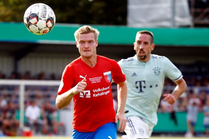 Drochtersen/Assel's Florian Nagel in action with Bayern Munich's Franck Ribery.