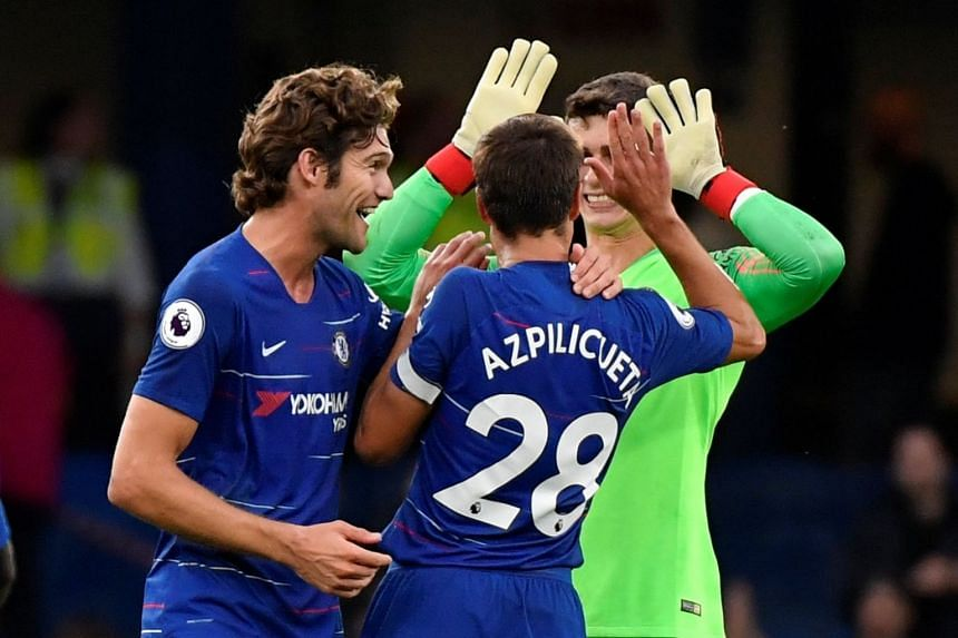 Chelsea's Marcos Alonso celebrates with Cesar Azpilicueta and Kepa Arrizabalaga at the end of the match.