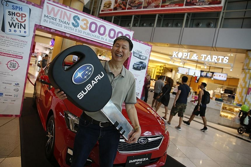 Mr Wong Chee Seng (above) and Mr Ho Kim Soon (right) took public transport to get to Suntec City yesterday for the annual Singapore Press Holdings (SPH) Shop & Win live prize draw, but they could soon be out on a new set of wheels. The two turned out
