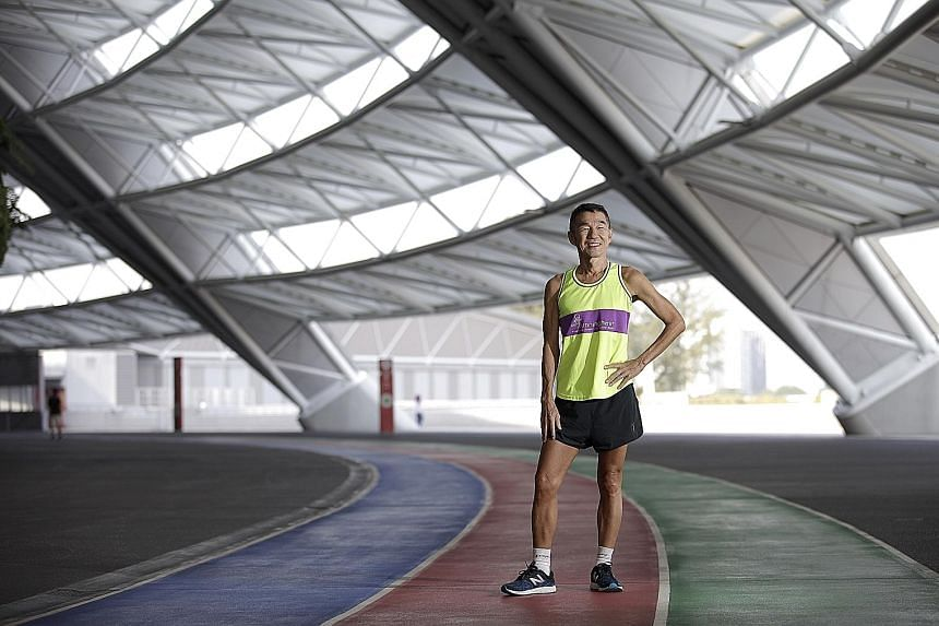 Mr Koh Kwee Boon, 64, was diagnosed with retinitis pigmentosa, a condition that causes a gradual loss of vision, when he was 40. Four years ago, he had to give up running completely. Born with clear vision, he had run full marathons in his youth. In