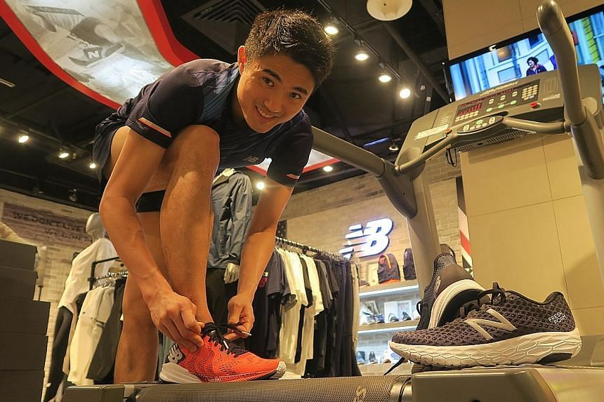 Mok Ying Ren preparing to try out New Balance's new line of running shoes on an in-store treadmill.
