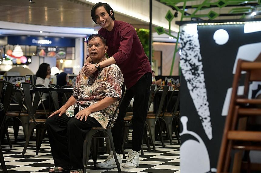 Mr Mashruddin Saharuddin and his youngest son Nizaruddin, who started following the older man on his busking rounds when he was 13. On Aug 9, at the National Day Parade show, their story was featured as part of a filmlet on inspirational Singaporeans