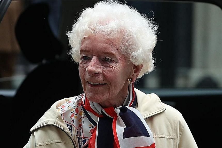 """World War II pilot Mary Ellis in central London on May 23, for a reception hosted by Britain's Prime Minister Theresa May as part of the Royal Air Force's 2018 centenary celebrations. Battle of Britain veterans Wing Commander Tom """"Ginger"""" Neil (left)"""