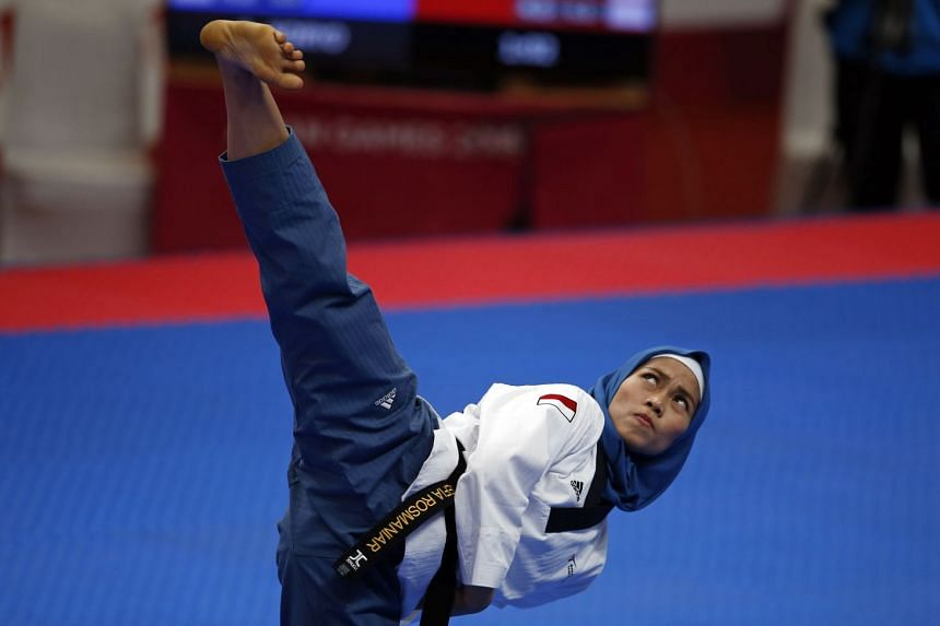 Defia Rosmaniar of Indonesia won Indonesia's first gold medal, in the women's individual poomsae, at the Asian Games on Aug 19, 2018.
