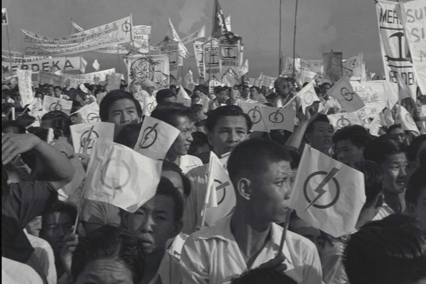 """People attending a Merdeka rally at Kallang Airport in 1956. PM Lee Hsien Loong announced a """"Merdeka Generation Package"""" for those born in the 1950s and grew up in the tumultous years of the 1950s and early 1960s."""
