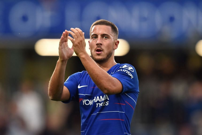 Hazard applauds supporters after the match.
