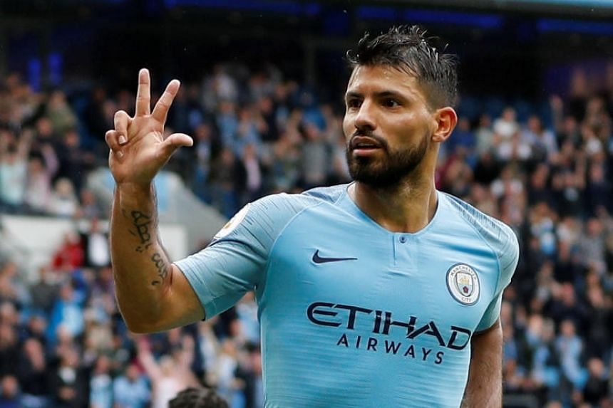 Manchester City's Sergio Aguero celebrates scoring their fifth goal to complete his hat-trick against Huddersfield Town at the Etihad Stadium in Manchester on Aug 19, 2018.