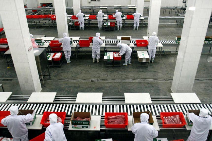 Cuts of fresh pork being sorted inside a Shuanghui factory in Zhengzhou, Henan, China.
