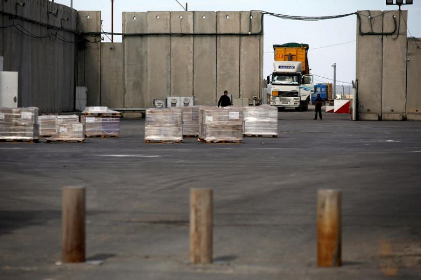 A truck parks next to a security barrier inside the Kerem Shalom border crossing terminal between Israel and Gaza Strip, on Jan 16, 2018.