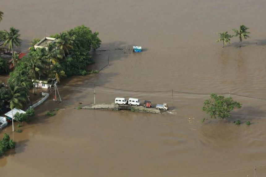 Rescuers in helicopters and boats fought through renewed torrential rain to reach stranded villages  as the toll from the worst monsoon floods in a century rose above 320 dead in Kerala, India, on Aug 18, 2018.