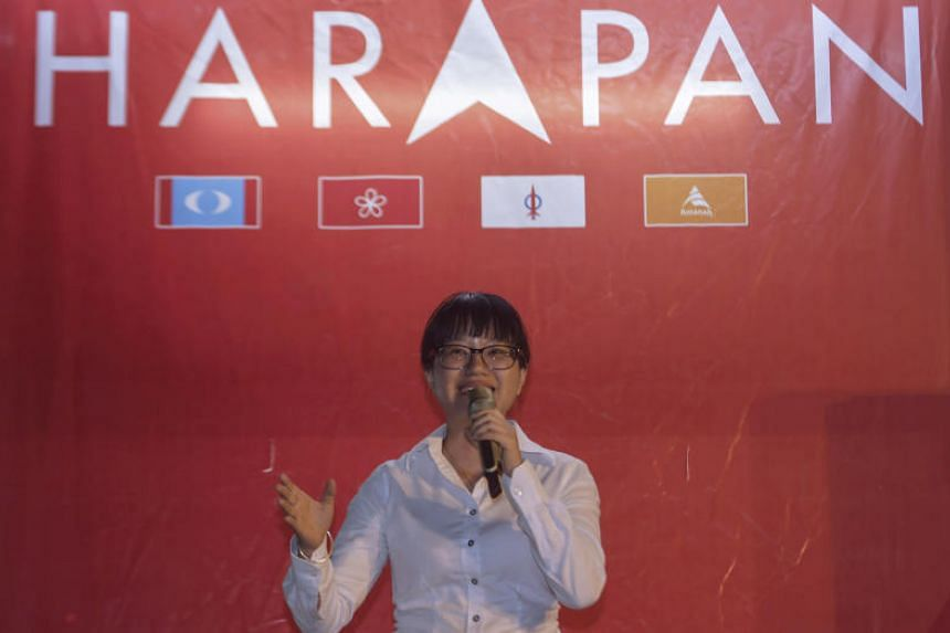 Pakatan Harapan's candidate for the Balakong state-seat by-election Wong Siew Ki in front of the party's logo.