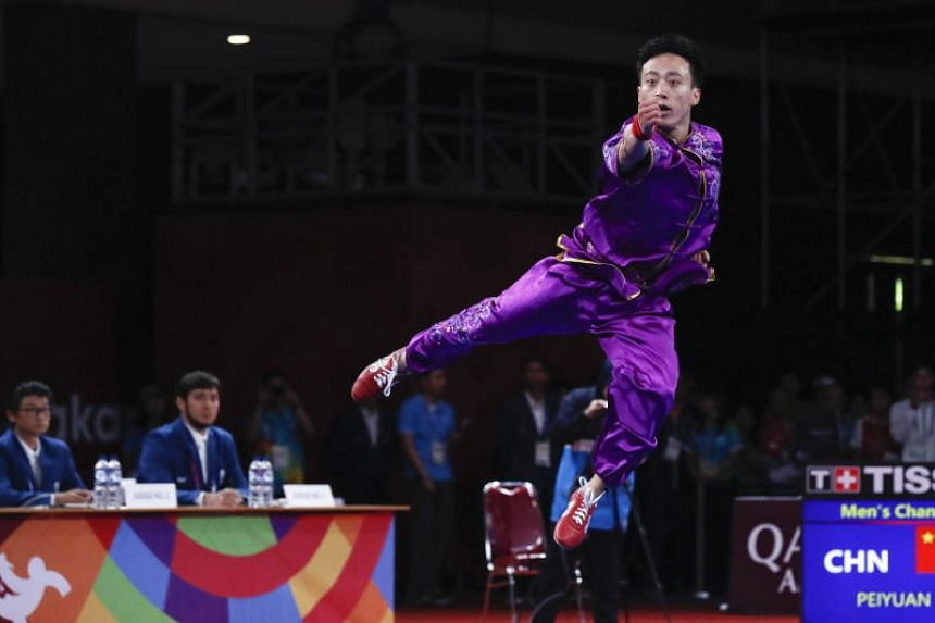 Sun Peiyuan clinched the men's changquan gold with 9.75 points after impressing with his acrobatic moves at the Jakarta International Expo, in Jakarta, on Aug 19, 2018.