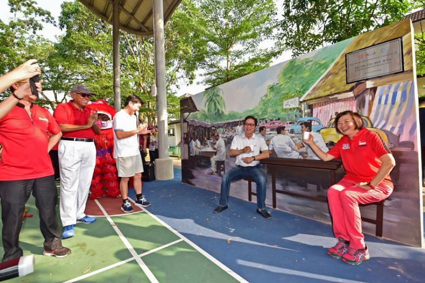 Nee Soon GRC MP Lee Bee Wah (right) and Nee Soon Town Council member Alex Lee posing with a mural depicting Goodlink Park, near Sembawang Road, on Aug 19, 2018.