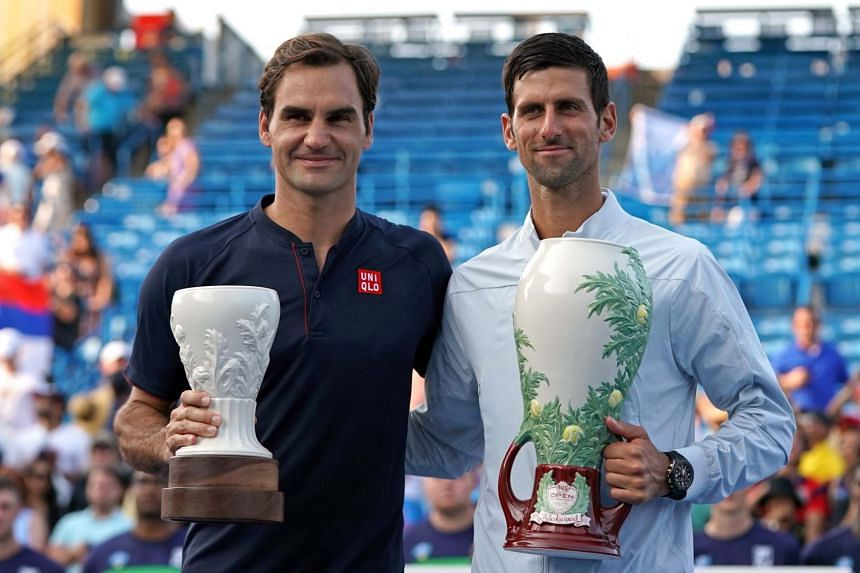 Roger Federer (left) and Novak Djokovic posing for photos after the finals in the Western and Southern tennis open at Lindner Family Tennis Center.
