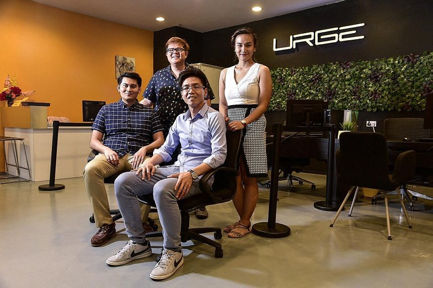 (Clockwise from left) Mr Muhammad Shabreen Hussain, who is spearheading Urge's Malaysian business, chief liaison officer Derrick Neo, marketing officer Sayat Sherlyn Parungao and chief operating officer Kelvin Ho. The firm has a fleet of about 100 ca