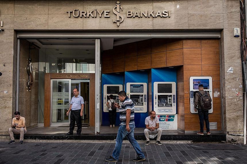 A branch of Turkiye Is Bankasi, Turkey's largest bank, in Istanbul. Markets are emerging from a week dominated by Turkey's spat with the United States, with the falling Turkish lira having an alarming effect on emerging market currencies However, mor