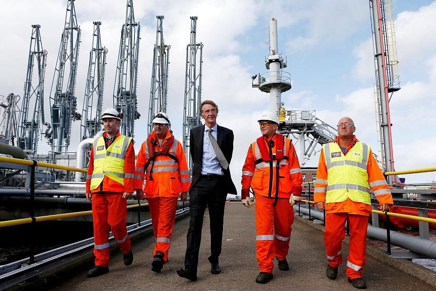 Mr Jim Ratcliffe (in suit) founded the Ineos chemicals group in 1998. The group, in which he owns 60 per cent, now has annual sales of US$60 billion and employs over 18,000 people in 24 countries.