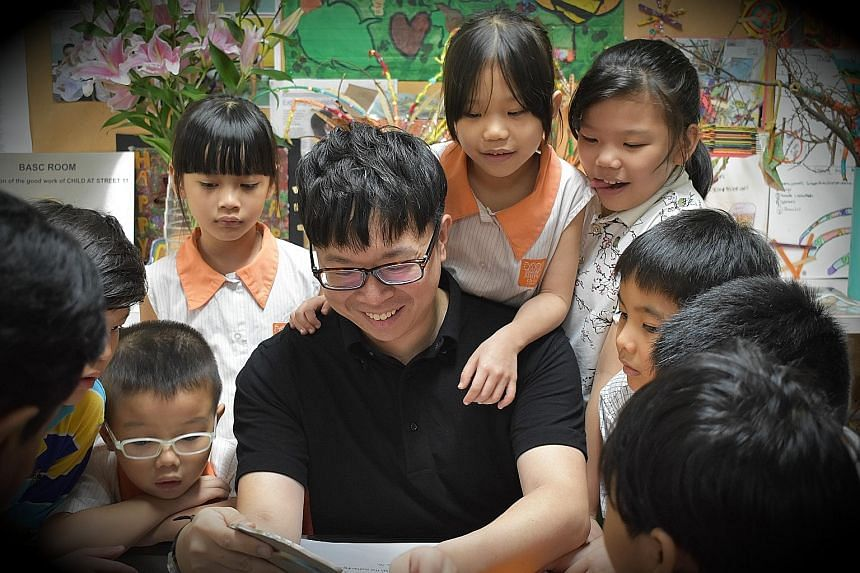 Conductor and composer Wong Kah Chun with children from Project Infinitude, an initiative he co-founded to bring music to underprivileged children and those with special needs.