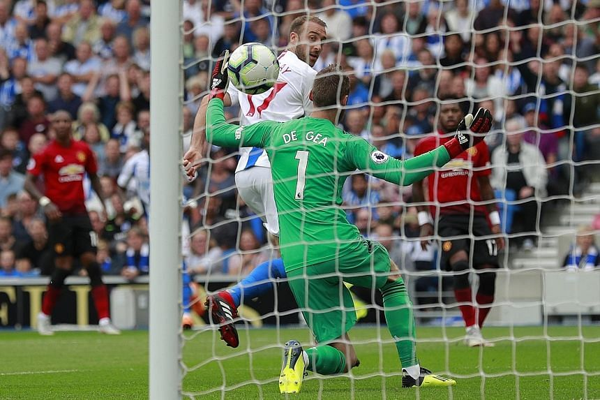 Brighton striker Glenn Murray scoring past Manchester United goalkeeper David de Gea in the 25th minute to give the home side the early lead in yesterday's Premier League clash. Barely two minutes had passed before defender Shane Duffy made it 2-0 wi