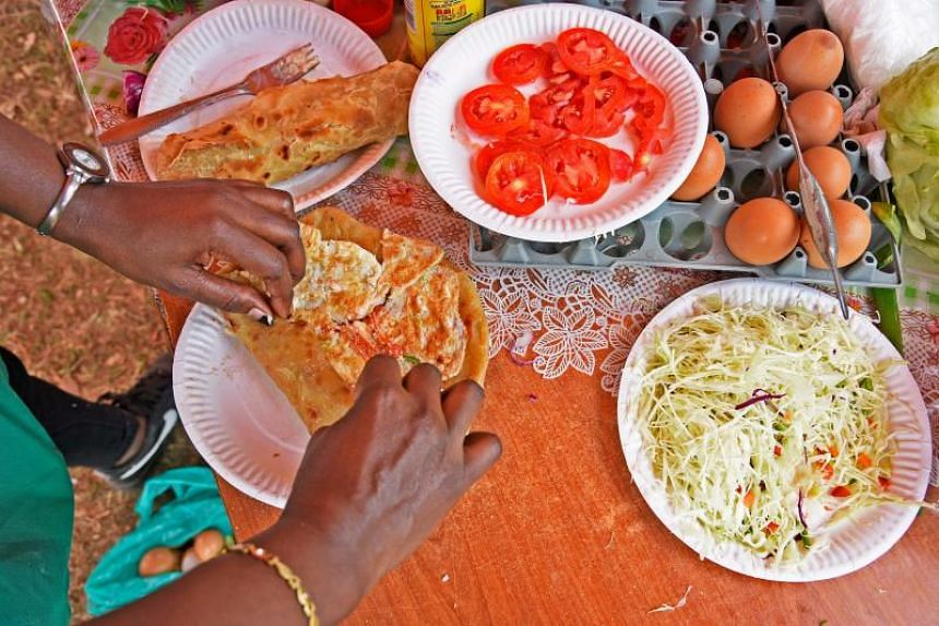 "The ""Rolex"" is prepared by rolling together chapatti and omelet spiced with vegetables like sliced tomatoes, onions and cabbage, which takes at most 5 minutes to prepare."
