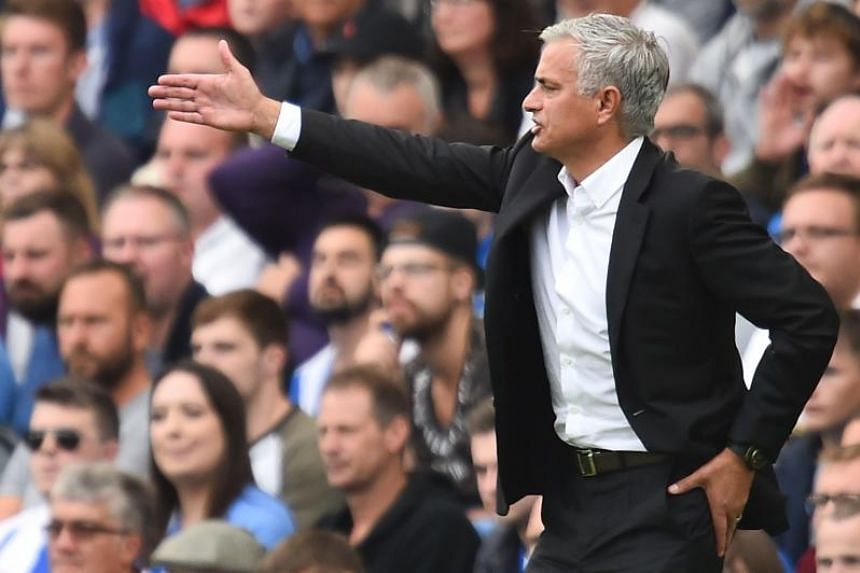 Manchester United's manager Jose Mourinho gestures from the touchline during the match between Brighton and Hove Albion and Manchester United at the American Express Community Stadium in Brighton, southern England on Aug 19, 2018.